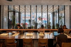 A communal table in the lobby at the Ace Hotel Shoreditch in London, designed by local firm Universal Design Studio. Ace Hotel London, London Hotels, London Cafe, Ace Hotel New York, Shanghai Hotels, London Food, Hotel Lobby, Hotel S, London Coffee Shop