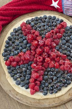 Patriotic Sugar Cookie Fruit Pizza dessert recipe will be the star of the show at your summer 4th of July party! Fresh fruit and sweet cream cheese filling!