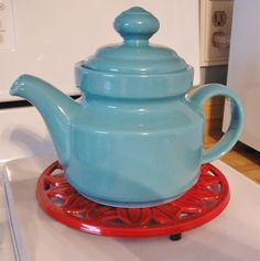 Made-in-Spain teapot and red trivet - found in thrift store