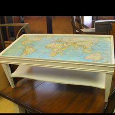 Map coffee table...maybe done with a map of the moon...