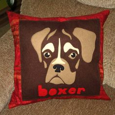 Kate Erbach's mom loves boxers so she created this pillow for her using a design meant for carving pumpkins. This appliqué is wool felt background, seen to a fabric back and stuffed with a Poly-Fil insert. She loves it!