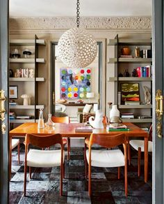 Modern art in dining space with wood table and chairs