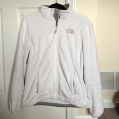 North Face Women's Fleece Size Medium North Face Women's Fleece Size Medium! In good condition! Has some discolored marks on the tips of the wrist area but not noticeable unless close up! Has some discoloration in spots but nothing horrible(picture 4 has the only yellowed spot on the jacket). The zipper is frayed a bit but not bad! Still has a lot of life left and still very comfy and warm!! Great white color to match everything! North Face Jackets & Coats