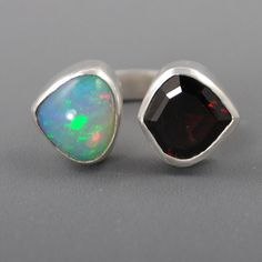Opal and Garnet Twins Ring di danaevansstudio su Etsy