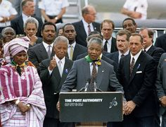 """Photo honoring Mario  Cuomo on Tributes.com. """"FILE - In this June 20, 1990, file photo, Nelson Mandela addresses the crowd at John F. Kennedy International Airport after arriving in New York. With Mandela from left are Winnie Mandela"""