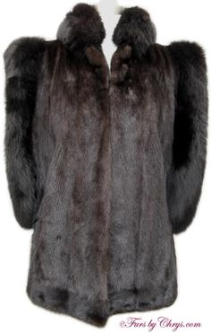 SOLD! Ranch Mink Black Fox Fur Vest #RMF716; Excellent Condition; 4 - 8 Petite, Average or Tall. This is a stunning genuine ranch mink fur vest with dyed black fox collar and trim around the arm openings. It has an Elan Furs label and features a small stand-up collar. This is one of those rare furs that may be worn so many ways: it can be dressed up or down, and is a sexy, sassy piece that enhances so many outfits. This ranch mink vest is just what your wardrobe needs to add a little spice!