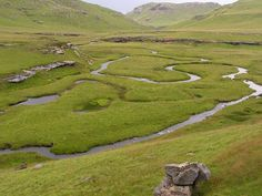 """Sehlabathebe National Park - Lesotho's first national park, proclaimed in 1970, is remote, rugged and beautiful, and getting there is always a worthwhile adventure, especially if you're into wilderness, seclusion and fishing. Sehlabathebe means the """"Shield of the Plateau"""", mirroring the rolling grasslands, wild flowers and silence provide a sense of complete isolation."""