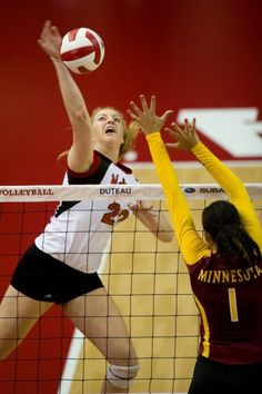 Minnesota's Daly Santana (1) attempts to block a kill from Nebraska's Meghan Haggerty (20) during the fourth set of the game on Sunday, Oct. 14, 2012 at the Nebraska Coliseum. The Huskers won 3-1 over the Golden Gophers. (ADAM WOLFFBRANDT/Lincoln Journal Star)