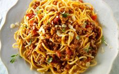 """Lucinda's version of bolognese sauce takes just a third of the time of the original to prepare. Serve it over spaghetti or any pasta you may have in the pantry. From the book """"Mad Hungry,"""" by Lucinda Scala Quinn (Artisan Books). Italian Pasta Recipes, Italian Dishes, Pasta Dishes, Food Dishes, Main Dishes, Rice Dishes, Pasta Sauces, Dishes Recipes, Potato Recipes"""