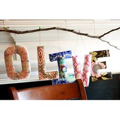 fabric wrapped and padded letters......can be wood or foam.