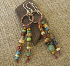 Multi Colored Beads Dangling from Copper Hoops by marynewton, $28.00