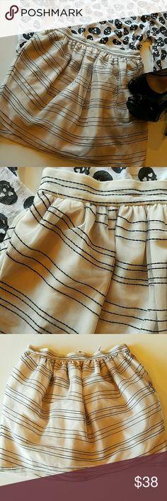 "BCBGeneration slirt Adorable tulle skirt, NEW, never worn.Black stripes on ivory color tulle, fully lined. Inseam POCKETS!  Waist 13.5"", lenght 15"" BCBGeneration Skirts"