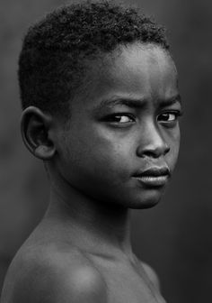 Faces of Africa, boy, kid, child, strong, powerful, portrait, culture, intense eyes, soul, photograph, photo b/w.