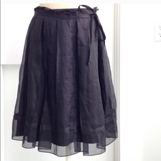 Dkny black tulle skirt. Black tulle skirt with tie detail. 100% silk. Like new. DKNY Skirts A-Line or Full