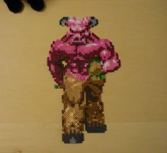 From the pc version of DOOM, it's a flyin' skull! Made of Perler fuse beads, and possibly some Hama beads as well. Original sprite sheet located at spriters-resource.com, ripped by Ultimecia.