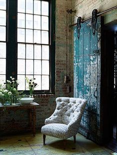 Love how simple and serene this area is...the chair, color, flowers, and light..❤
