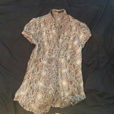 Express XS sheer buttoned top. Grey sheer top . Versatile could be worn dressed up for day at office. Also with jeans and heels for night out . Express Tops