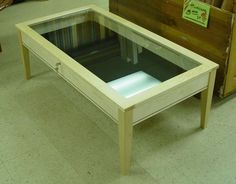 This is a shadow box coffee table. I love this for a living room or family room, game room whatever (I guess depending on what you put in it) Great idea!