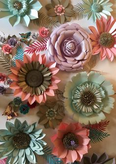 A beautiful set of flowers created for a baby shower. The colours are mint, lavender, coral with accents of pearl gold. Contact www.paperflowercompany.com for details and other colours and styles.