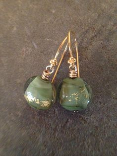 Visit Ladonnastudio on Etsy: Sage Green Dangle Earrings Venetian Glass Earrings Green and Gold Glass Discs Gold Filled Earrings