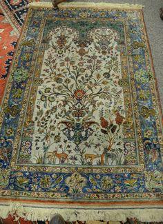 "Silk Oriental prayer rug with animals and birds. 4' 8"" x 7' Realized Price $4,200.00"