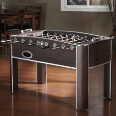 American Heritage Atlantis Foosball Table by American Heritage. $799.95. 390006 Features: -Classic parquet playing surface.-Two scoring units. Includes: -Traditional rugby players included. Color/Finish: -Accent chrome.. Save 30%!