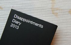 "The Disappointments Diary, written by Nick Asbury, designed by Hat-trick Design, and published by Asbury & Asbury, was created for the realest of multi-taskers. It has the standard calendar with daily quotes that you remind you of life's realities plus lists to keep track of ""People That Owe You Money"" and ""People Who Never Call."" Get yours for the new year on disappointmentsdiary.com."