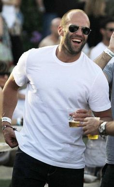 Whatever kind of beer you are drinking, I want one.   And, I want you to serve it to me.  I love your sunglasses, I love your tee shirt, I love your smile and you are awesome Jason Statham, awesome.