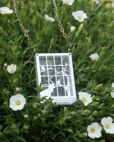 """Birdie TV Necklace by Designerica via etsy. Made from a layer of 5mm clear acrylic sandwiched between two pieces of laser cut aluminum on a sterling chain. It depicts a cat watching birds through a window as they twitter on the branches of a tree.Pendant is 1 1/2"""" (+1/4"""" at the sill) by 2 1/4"""" and 6.8mm thick."""