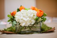 low orange, green, and white centerpiece | Floral: Bella Rosa | Photography:  Studio Blu