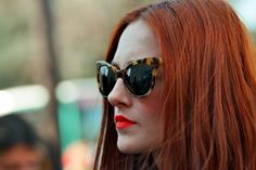 Taylor Tomasi-Hill so chic.  Love the cat eye sunnies and red lips!