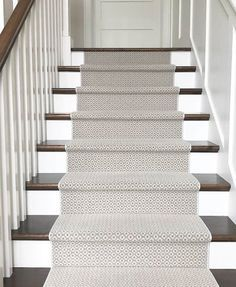 Patterned stair runner in blue and cream on wood tread stairs with white risers. Tile Stairs, Hardwood Stairs, Flooring For Stairs, Staircase Remodel, Staircase Makeover, Stairs In Living Room, House Stairs, Staircase Carpet Runner, Carpet Stair Runners