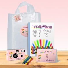 Big sister gift bag in pink. Everything she needs to capture memories of the new baby and treasure them in her photo album. Give her a gift she will love. Pack Of Crayons, Big Sister Gifts, Non Toy Gifts, Sister Photos, Gift Bags, Childhood Memories, Gifts For Kids, Coloring Books, New Baby Products