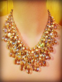 Gilded Age is a two-strand waterfall of champagne cultured pearls, Swarovski faceted teardrops, Czech glass faceted beads, and dozens of rhinestone
