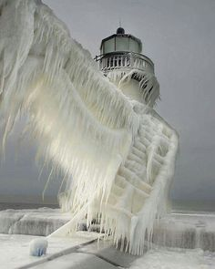 Frozen light house in Michigan after snowstorm