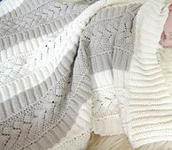 Knitted in soft cotton, this beautiful baby blanket will become a family heirloom.