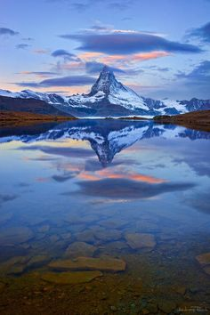 Switzerland - Matterhorn and Stellisee.  The Stellisee is an idyllic mountain lake reached in only 20 minutes from the Blauherd station. The lake reflects the most impressive face of the Matterhorn