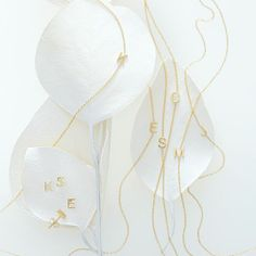 Maya Brenner initial necklaces.
