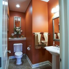 bathrooms painted in a terra cotta | brian killian peters photography