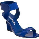 """Manolo Blahnik's """"Pepewe"""" Patent leather open-toe wedge sandal, 3 1/2"""" heel with elastic ankle strap. Available at Barneys.com"""
