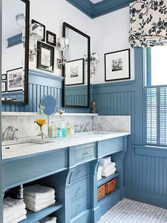 Who says bead board has to be white? The soft and calming blue color becomes the neutral in this space while the crisp white marble and walls are juxtaposed as an accent! Brilliant!