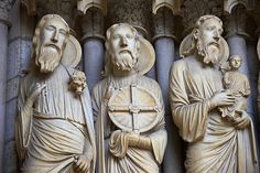 Pictures of the sculptures from the North Porch, Central Portal, right Jambs- General View c. 1194-1230. Cathedral of Chartres, France . Gothic statues of figures of, from left 1) Isaiah 2) Jeremiah 3) Simeon holding the Christ Child. A UNESCO World Heritage Site.