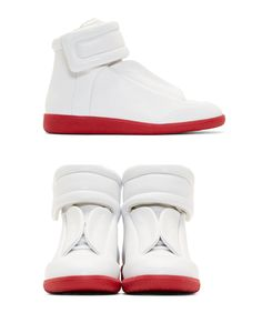 White Leather Future High-Top Sneakers by Maison Martin Margiela. Supple leather high-top sneakers in white. Round toe. Padded strap across concealed lace-up closure with Velcro fastening and off-white piping. Textured rubber foxing and sole in red. Supple leather lining in off-white. http://www.zocko.com/z/JJHO4