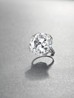 A 32.65 carat cushion-shaped diamond set as a ring by Chaumet (JEWELS FROM THE PATIÑO COLLECTION).