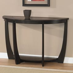 @Overstock - A rich espresso stain finish highlights this elegant Archer sofa table. This table is made of beautiful Birch veneer on top and features tempered glass, a storage shelf and non-mar foot glides.http://www.overstock.com/Home-Garden/Archer-Espresso-Sofa-Table/5749776/product.html?CID=214117 $196.99