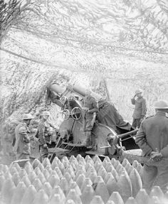 """Royal Garrison Artillery 9.2"""" Howitzer of 91st Battery, Royal Garrison Artillery in position under camouflage netting in readiness for the opening barrage of Arras, 1 April 1917"""".   The Royal Garrison Artillery (RGA) was an arm of the British Army's Royal Artillery that was originally tasked with manning the guns of the British Empire's forts and fortresses, including coastal artillery batteries, the heavy gun batteries attached to each infantry division, and the guns of the siege artillery."""