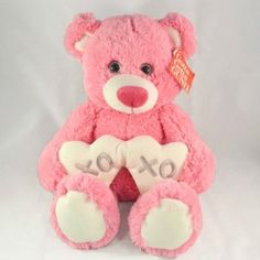 """Gemma XOXO Bear: Gemma comes in brilliant pink, sits at 10″ and carries a pair of white hearts that show she cares by expressing the term """" XOXO"""""""
