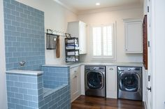 And here's another clever raised pet-washing station in a farmhouse laundry room by Keystone Millworks Inc. Via Houzz
