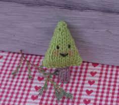 Christmas knitting pattern. Tiny knitted Christmas tree from my ebook, Little Christmas Knits full of easy knitting patterns for Christmas decorations and accessories.