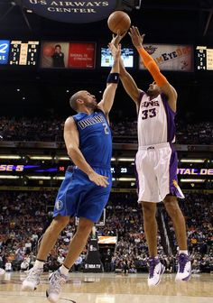 Grant Hill #33 of the Phoenix Suns puts up a shot over Jason Kidd #2 of the Dallas Mavericks during the NBA game at US Airways Center on February 17, 2011 in Phoenix, Arizona. The Mavericks defeated the Suns 112-106. NOTE TO USER: User expressly acknowledges and agrees that, by downloading and or using this photograph, User is consenting to the terms and conditions of the Getty Images License Agreement.